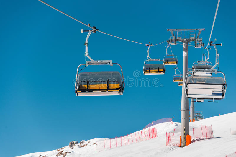 The ski lifts durings bright winter day. Ski lifts durings bright winter day stock photos