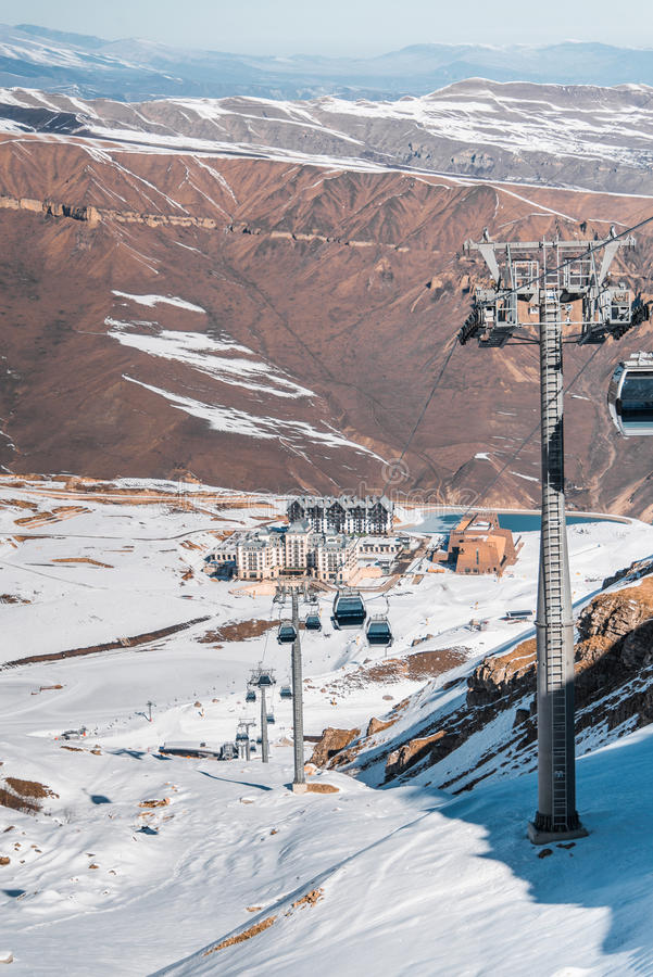 The ski lifts durings bright winter day. Ski lifts durings bright winter day royalty free stock photos