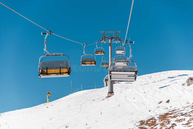 The ski lifts durings bright winter day. Ski lifts durings bright winter day royalty free stock image