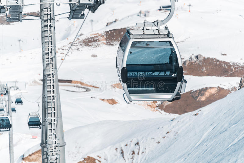 The ski lifts durings bright winter day. Ski lifts durings bright winter day stock image