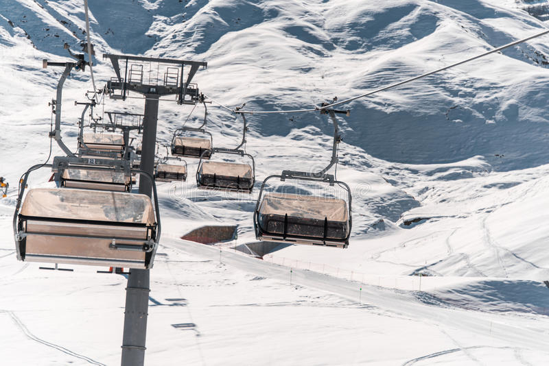 The ski lifts durings bright winter day. Ski lifts durings bright winter day stock photography
