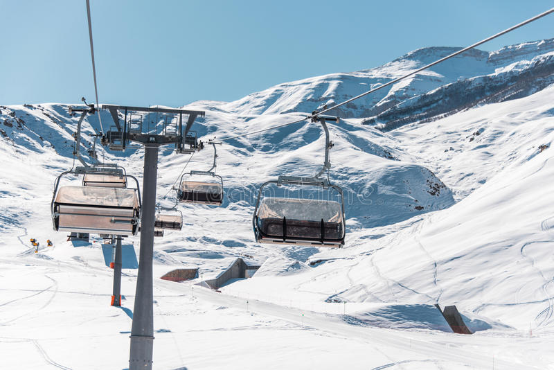 The ski lifts durings bright winter day. Ski lifts durings bright winter day royalty free stock photo