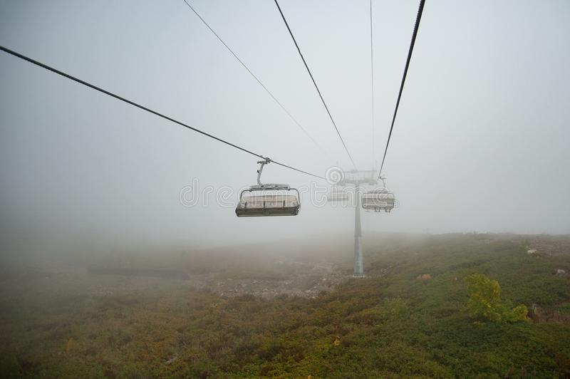 Ski lifts in the clouds stock image
