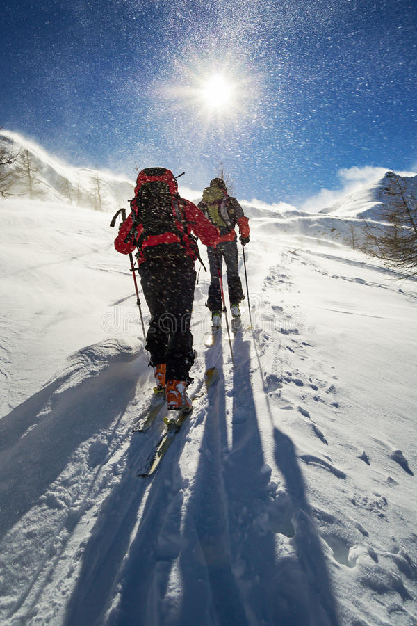 Ski mountaineering in snowstorm royalty free stock photography