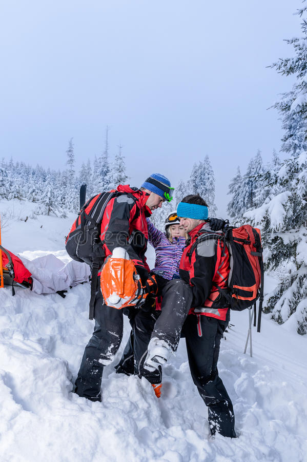 Ski patrol carry injured woman skier stretcher stock image