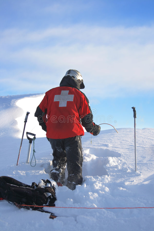 Ski patrol at work stock photography