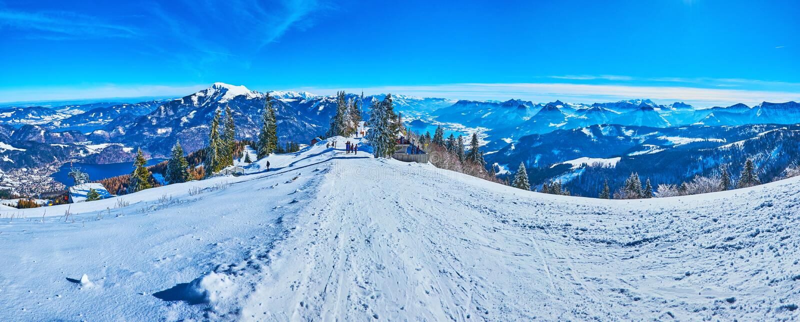 The ski pistes atop the Zwolferhorn, St Gilden, Salzkammergut, Austria. Panorama with wide comfortable ski pistes,  starting from the Zwolferhorn mountain peak royalty free stock photo