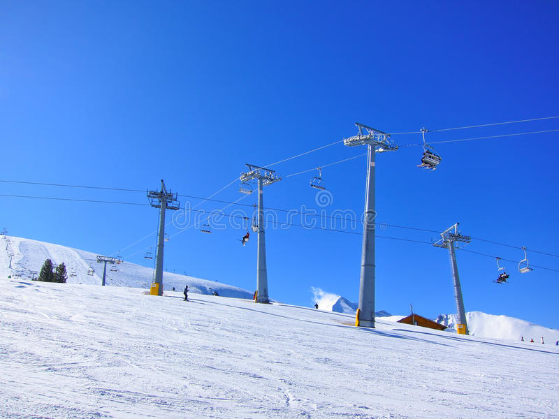 Ski Resort. Chairlifts on the mountain top of a ski resort stock photography