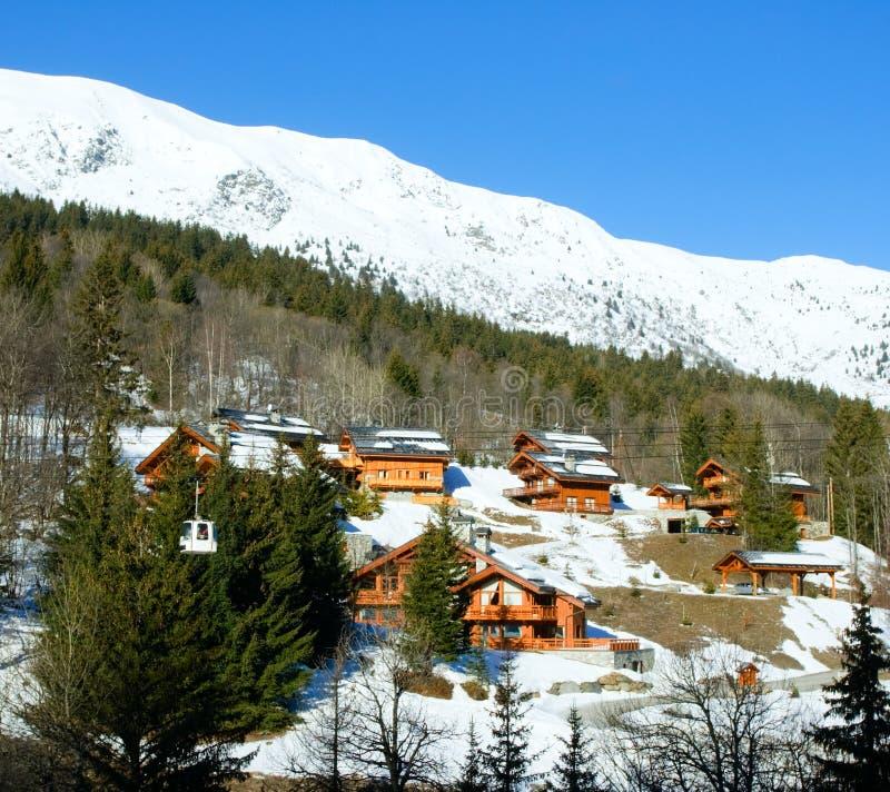 Ski resort. Chalets and ski lift cabin at Alpine ski resort royalty free stock photography