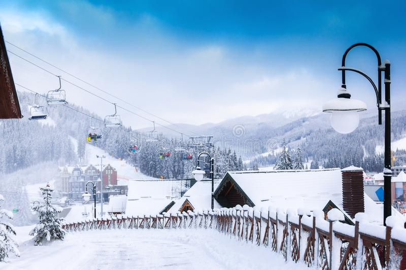 Ski resort with city view. Ski resort and winter city with road in the centre in the mountains stock photo