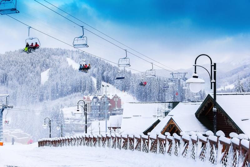 Ski resort with city view. Ski resort and winter city with road in the centre in the mountains stock images