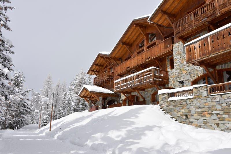 Ski resort hotel in the snow royalty free stock photo