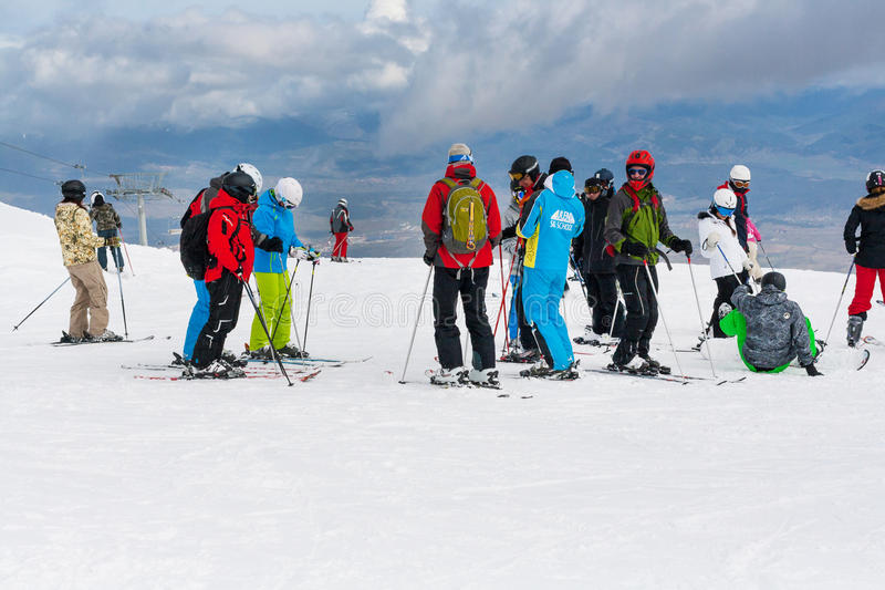 Ski resort, people at the high lift station, Bansko, Bulgaria. Bansko, Bulgaria - March 4, 2016: Ski resort, skiers at the high lift station, Bansko, Bulgaria royalty free stock photo