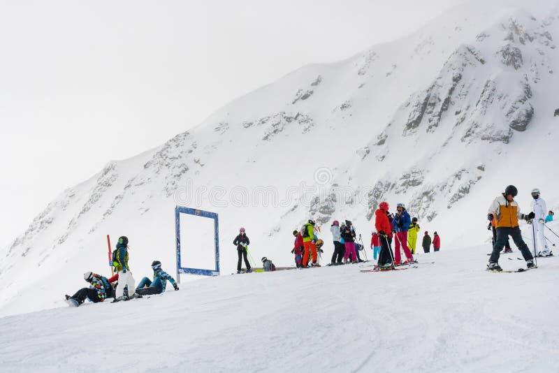 Ski resort, people at the high lift station, Bansko, Bulgaria. Bansko, Bulgaria - March 4, 2016: Ski resort, skiers at the high lift station, Bansko, Bulgaria stock image