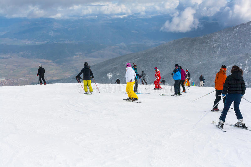 Ski resort, people at the high lift station, Bansko, Bulgaria. Bansko, Bulgaria - March 4, 2016: Ski resort, skiers at the high lift station, Bansko, Bulgaria royalty free stock photos