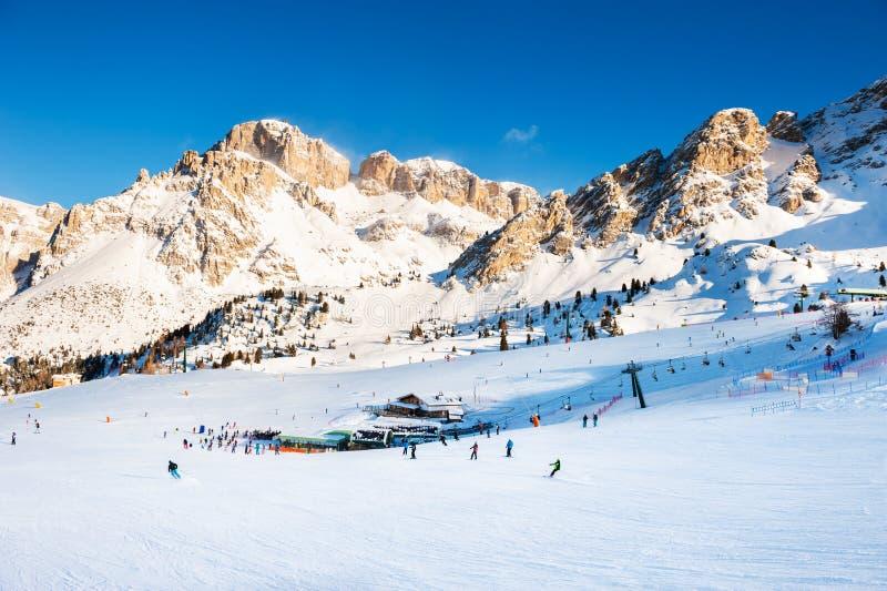 Ski resort in winter Dolomite Alps. Val Di Fassa, Italy. Ski slopes on ski resort in winter Dolomite Alps. Val Di Fassa, Italy. Winter holidays, travel stock photography