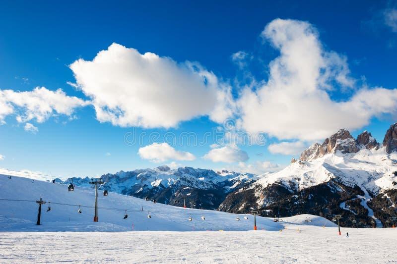 Ski resort in winter Dolomite Alps. Val Di Fassa, Italy. Ski slopes on ski resort in winter Dolomite Alps. Val Di Fassa, Italy. Winter holidays, travel stock images