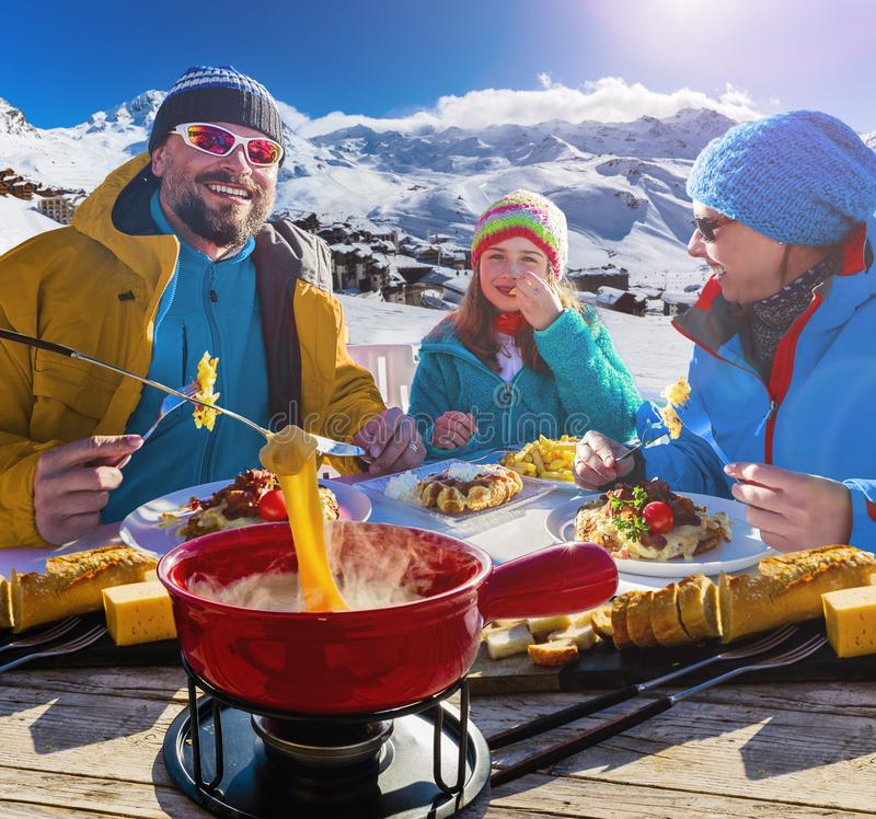 Ski restaurant lunch break with Fondue cheese. royalty free stock images