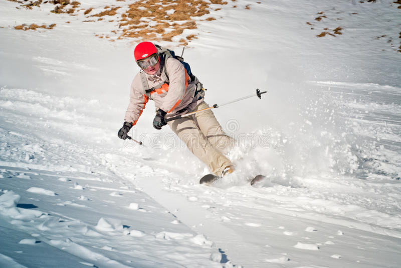 Download Ski rider in red helmet stock image. Image of physical - 25566733