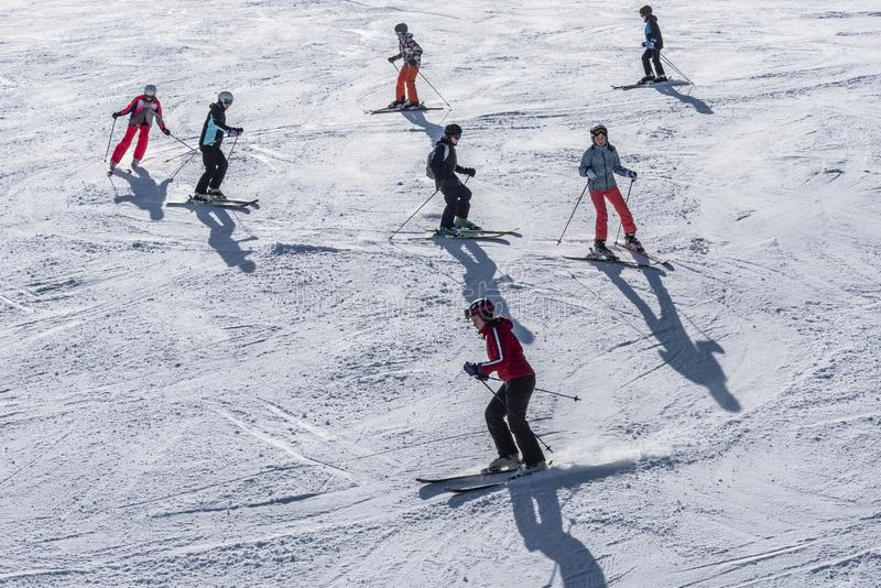 Ski school group training to turn Austria royalty free stock photography