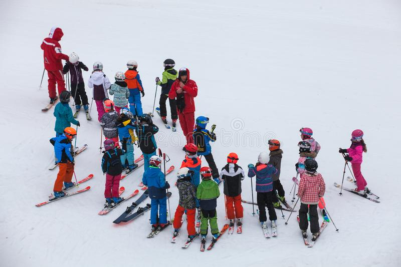 Ski school with numerous children in chamonix in France royalty free stock photo