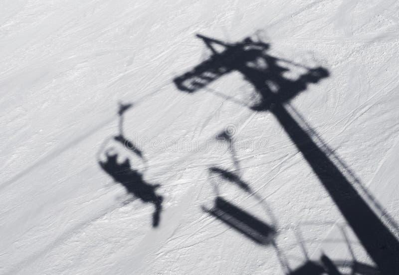 Ski shadow. Shadow of ski lift on snow stock photography