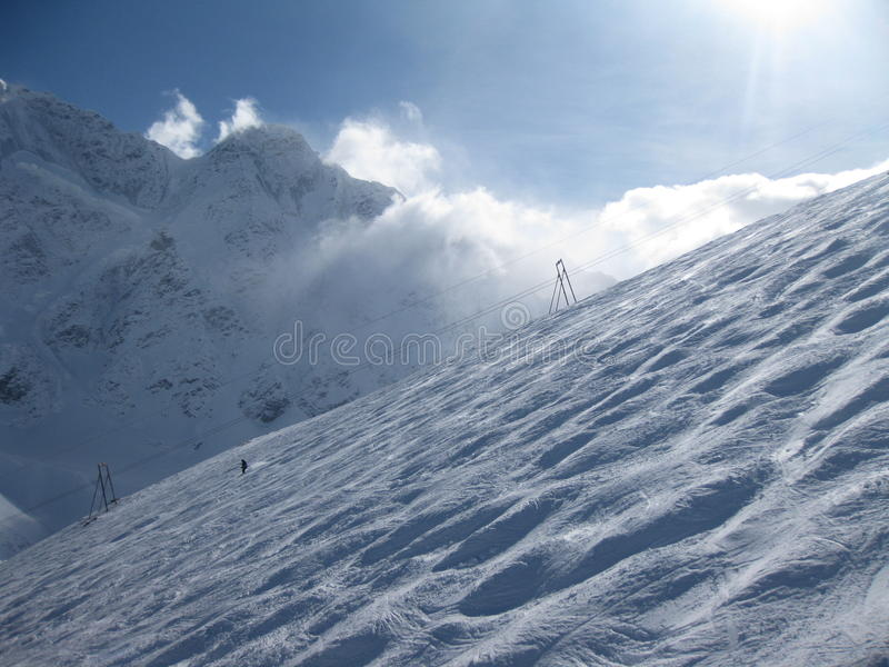 Ski slope at Elbrus mountains view in winter. royalty free stock photography
