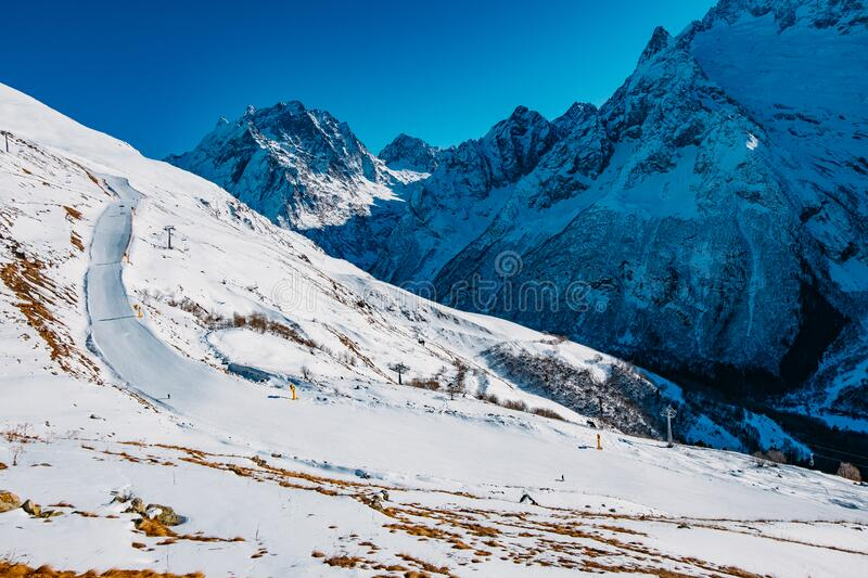 Ski slope in high mountains. Downhill skiing resort.  stock images