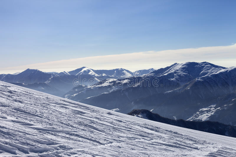 Download Ski Slope With Trace Of Ski, Snowboards And Mountains In Haze Stock Image - Image: 35207657