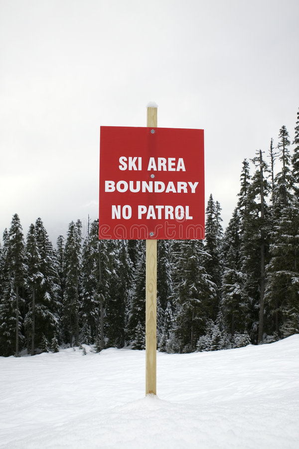 Ski slope warning of no patrol. Boundary sign at ski slope warning of no patrol stock photos