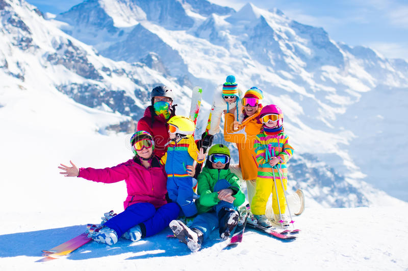 Ski and snow fun. Family in winter mountains. royalty free stock image