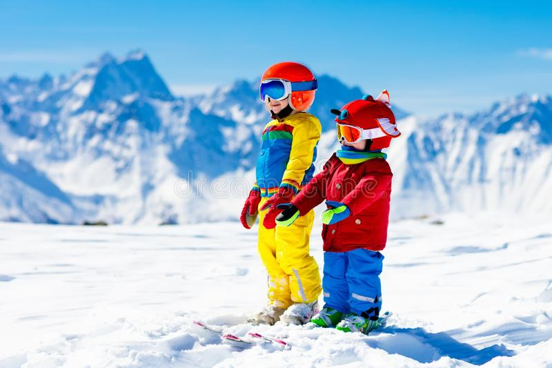 Ski and snow winter fun for kids. Children skiing. stock image