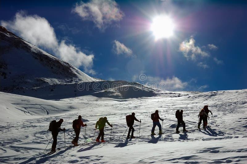 Ski touring group stock photos