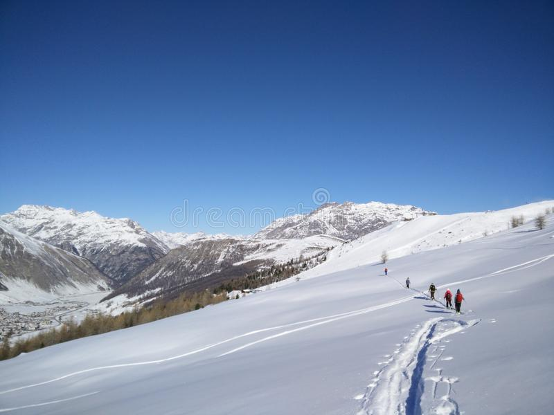 Ski-touring group in Livigno stock photos
