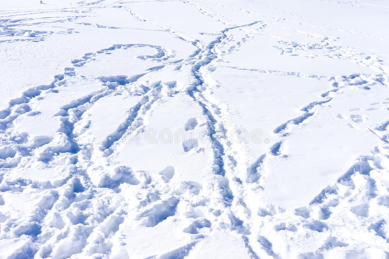 Ski traces on snow in winter mountains close-up royalty free stock photography