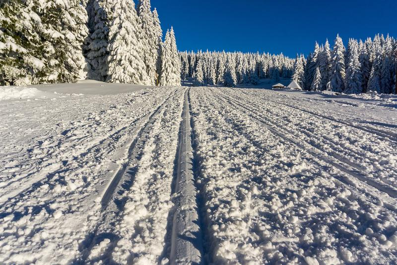Ski track on a mountain. Covered with snow stock photography