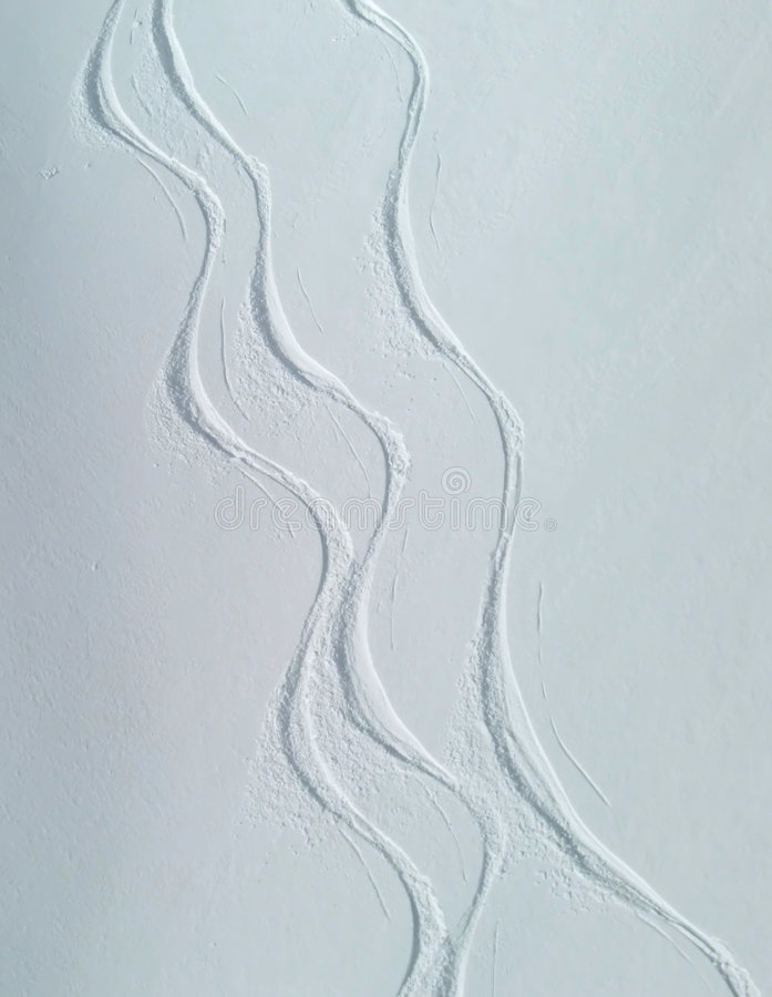 Free Ski Tracks On Snowy Slope Stock Images - 8037774