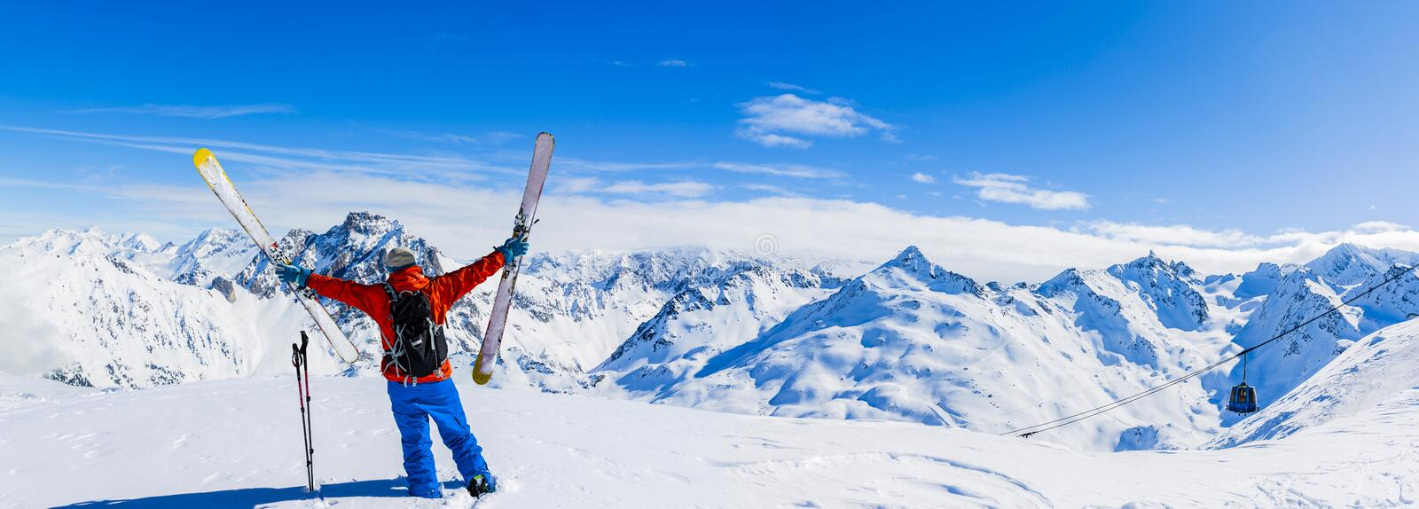Ski in winter season, mountains and ski touring equipments on th. E top in sunny day in France, Alps above the clouds stock images