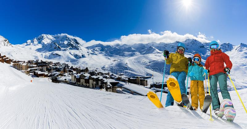 Ski in winter season, mountains and ski touring equipments on the top in sunny day in France, Alps above the clouds stock image