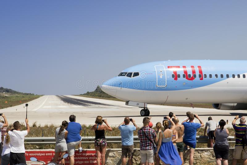 Edge of the runway where tourists flock to see aeroplanes land, Skiathos Town, Greece, August stock images