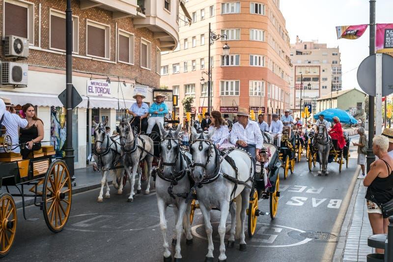 Skickliga ryttare och vagnar på Feria de Malaga arkivbilder