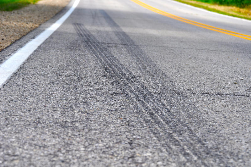 Skid Marks along a country road stock photos