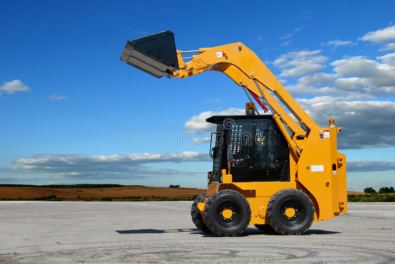 Skid steer loader construction royalty free stock photo