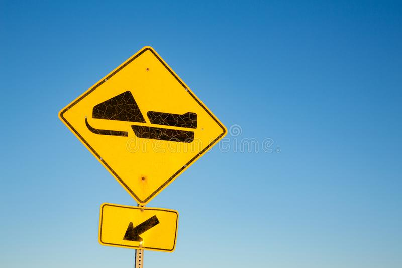 Skidoo or snowmobile road sign. Yellow road sign for Skidoo or Snowmobile trail, with blue sky background and space for text. Quebec Province, Canada stock image