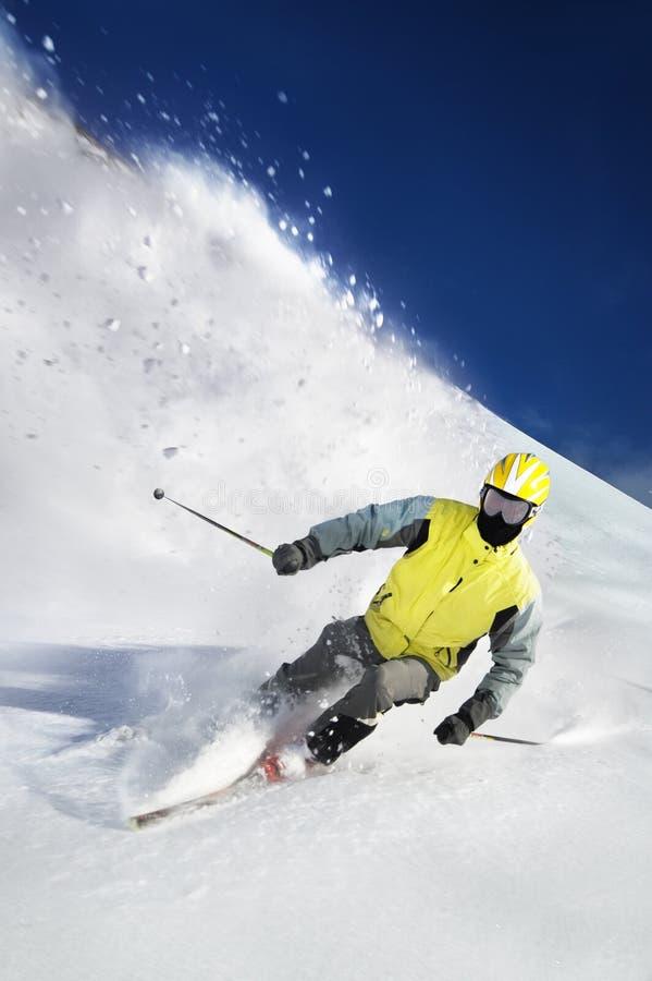 The Skier. Skier on the white snow royalty free stock photos