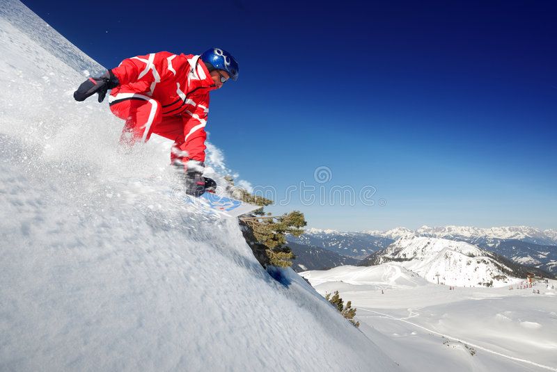 Skier. Snowboarder jumping from deep powder royalty free stock photos