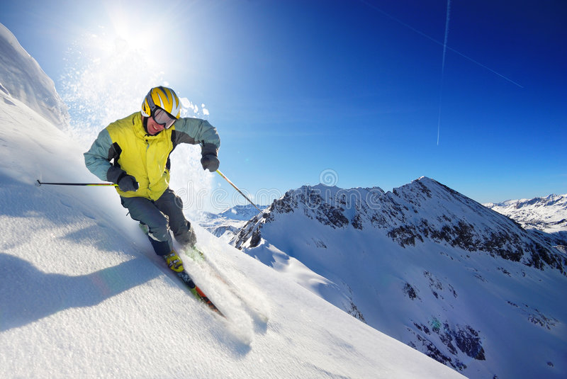 Skier. In the high mountines royalty free stock images