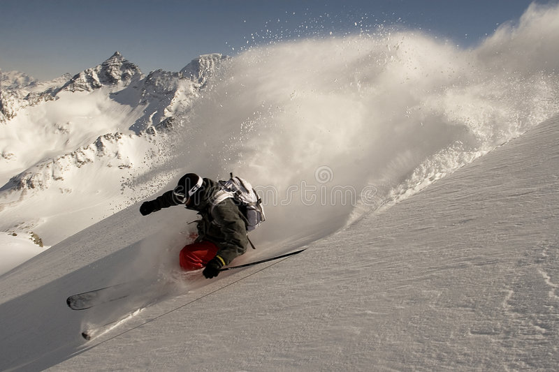 Skier. Mad skier in high mountains royalty free stock image