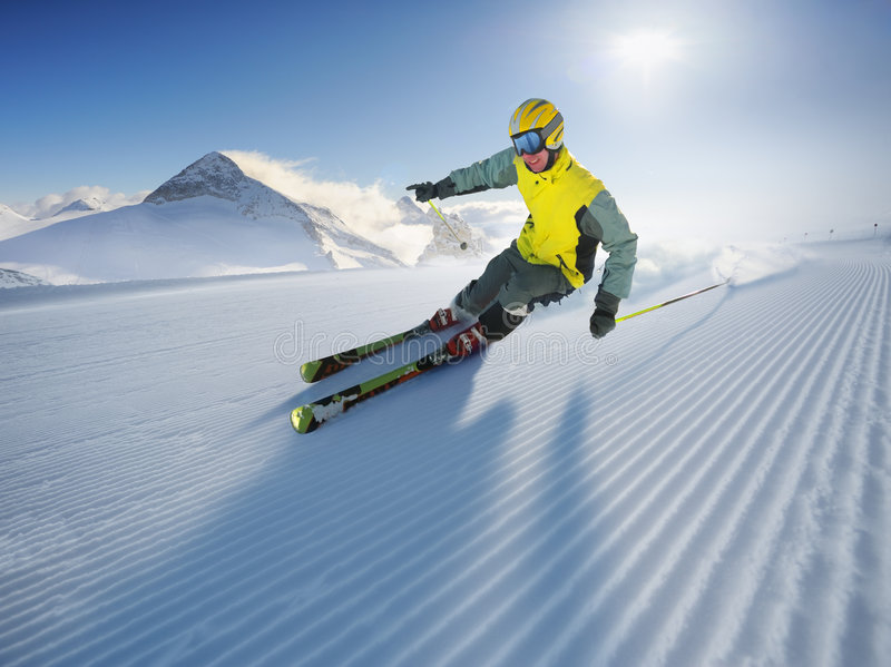 Skier. In high alpen mountains