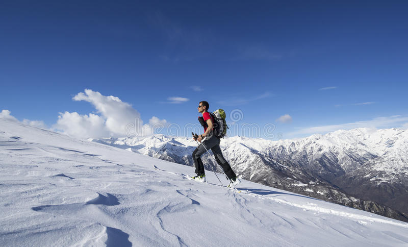 Skier ascending to the top stock photo